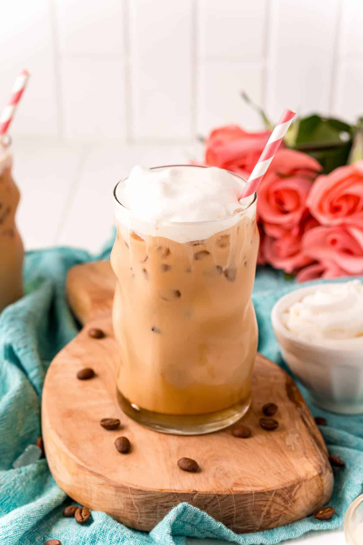 Whipped cream topped iced coffee.