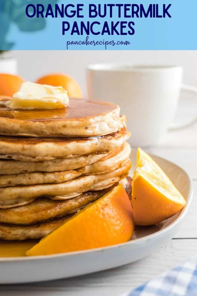 """Pancakes stacked on a plate, text overlay reads """"orange buttermilk pancakes, pancake recipes.com"""""""
