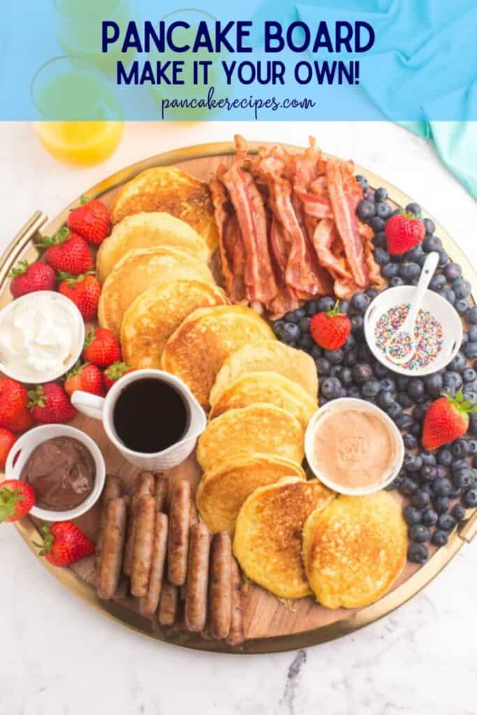 """Overhead view of a breakfast spread, text overlay reads """"pancake board, make it your own! pancakerecipes.com"""""""
