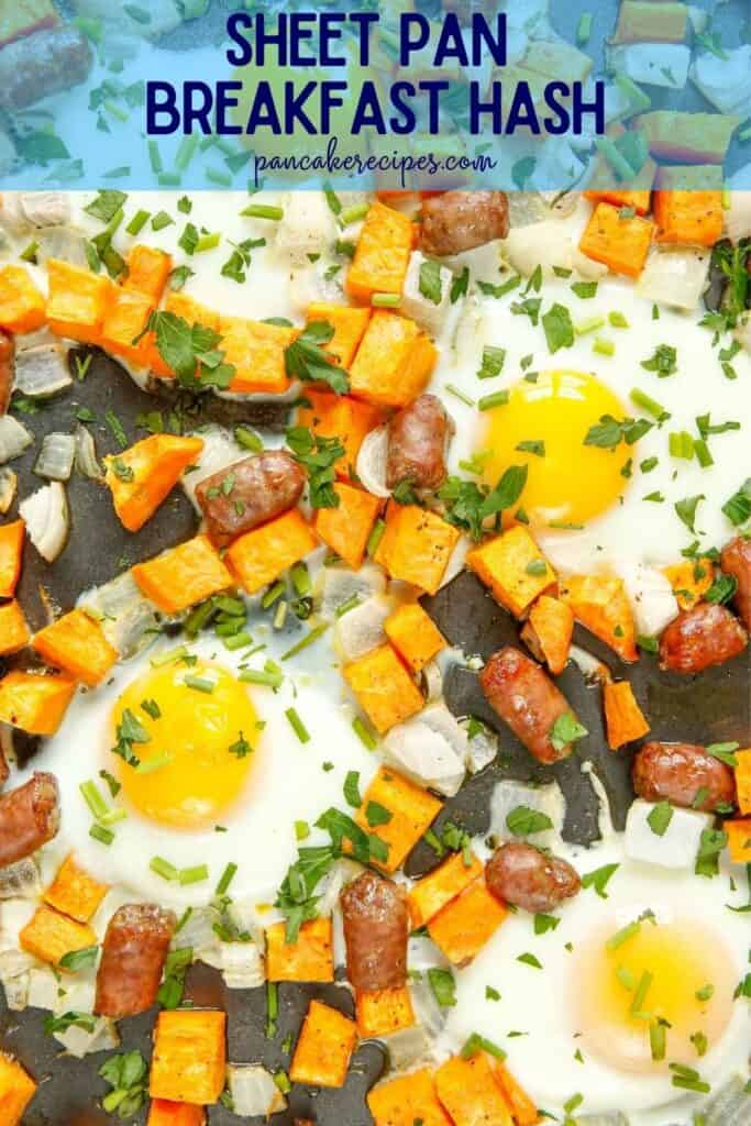 "Close up of eggs, sausage, and sweet potatoes on a sheet pan, text overlay reads ""sheet pan breakfast hash, pancakerecipes.com"""
