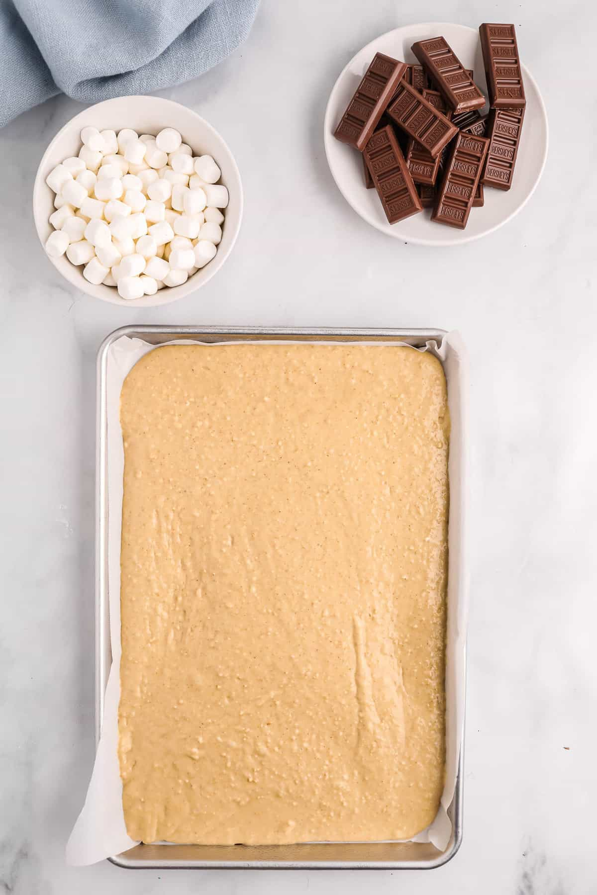 Pancake batter spread onto a sheet pan.