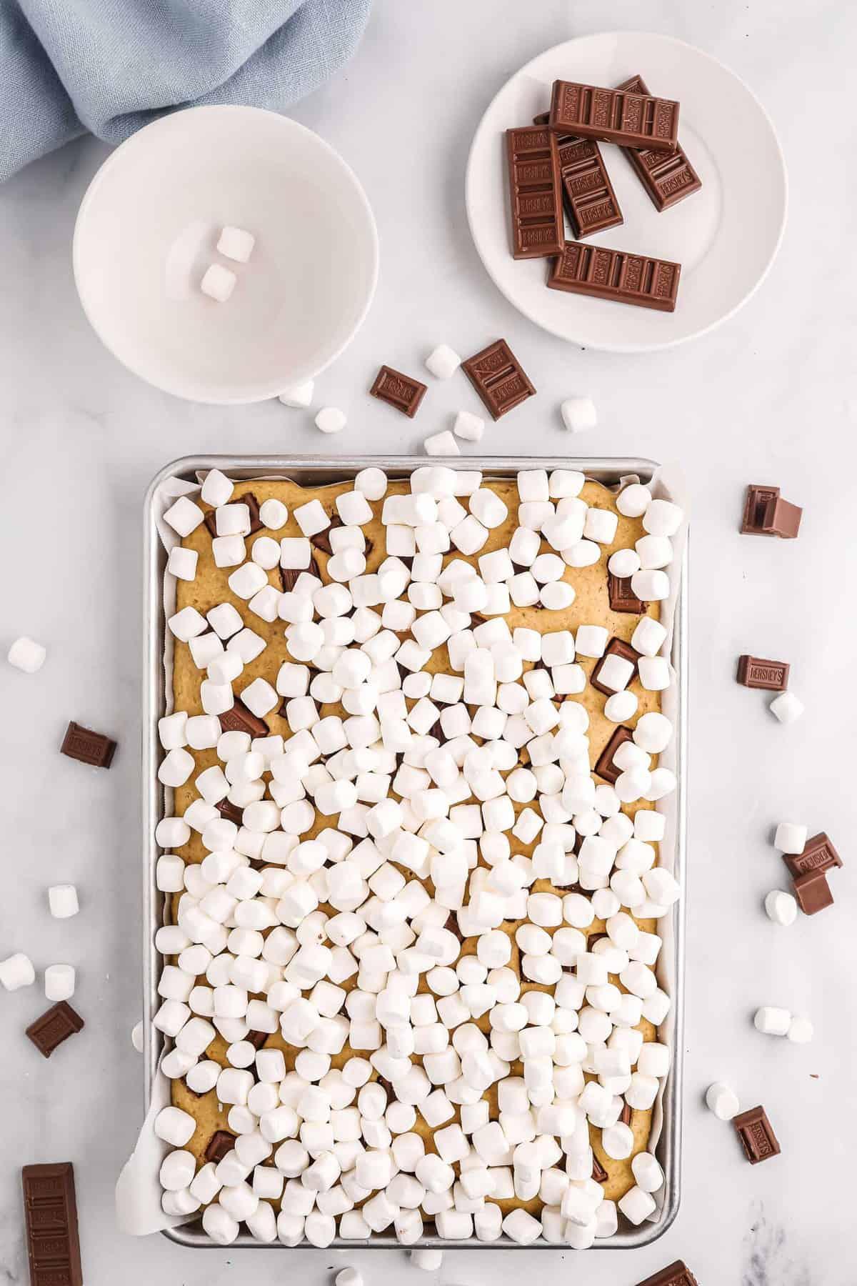 marshmallows on top of a sheet pan pancake.