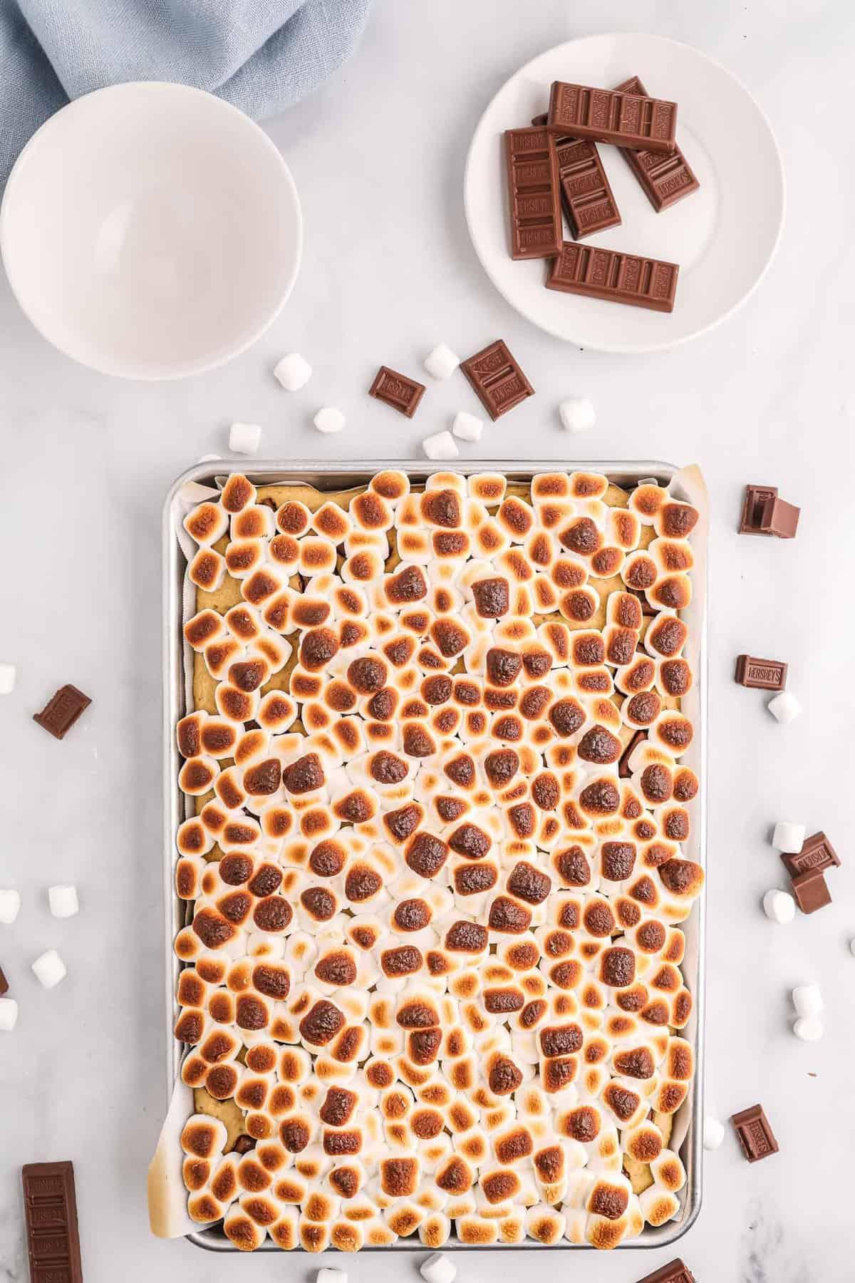 Toasted marshmallows on top of a sheet pan pancake.
