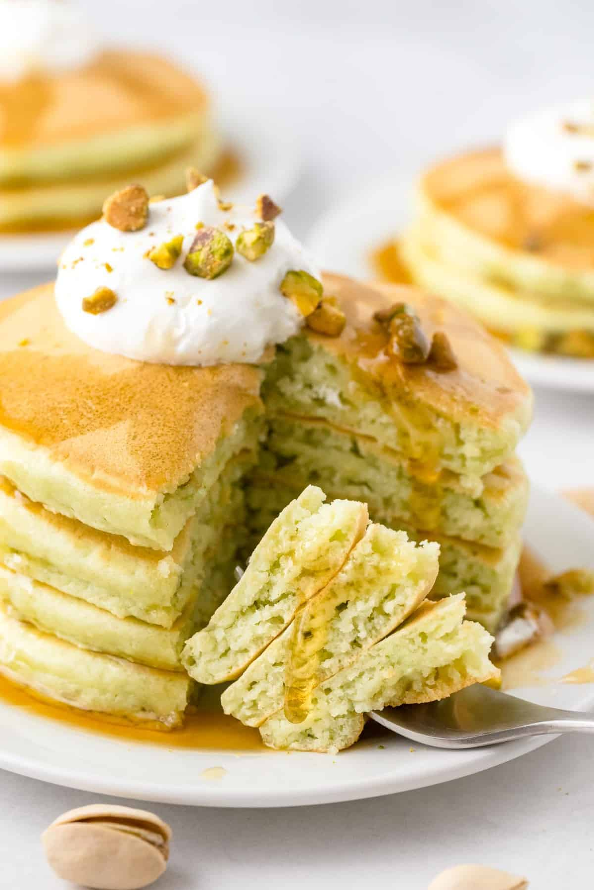 Stack of pistachio pancakes, cut out to see texture.