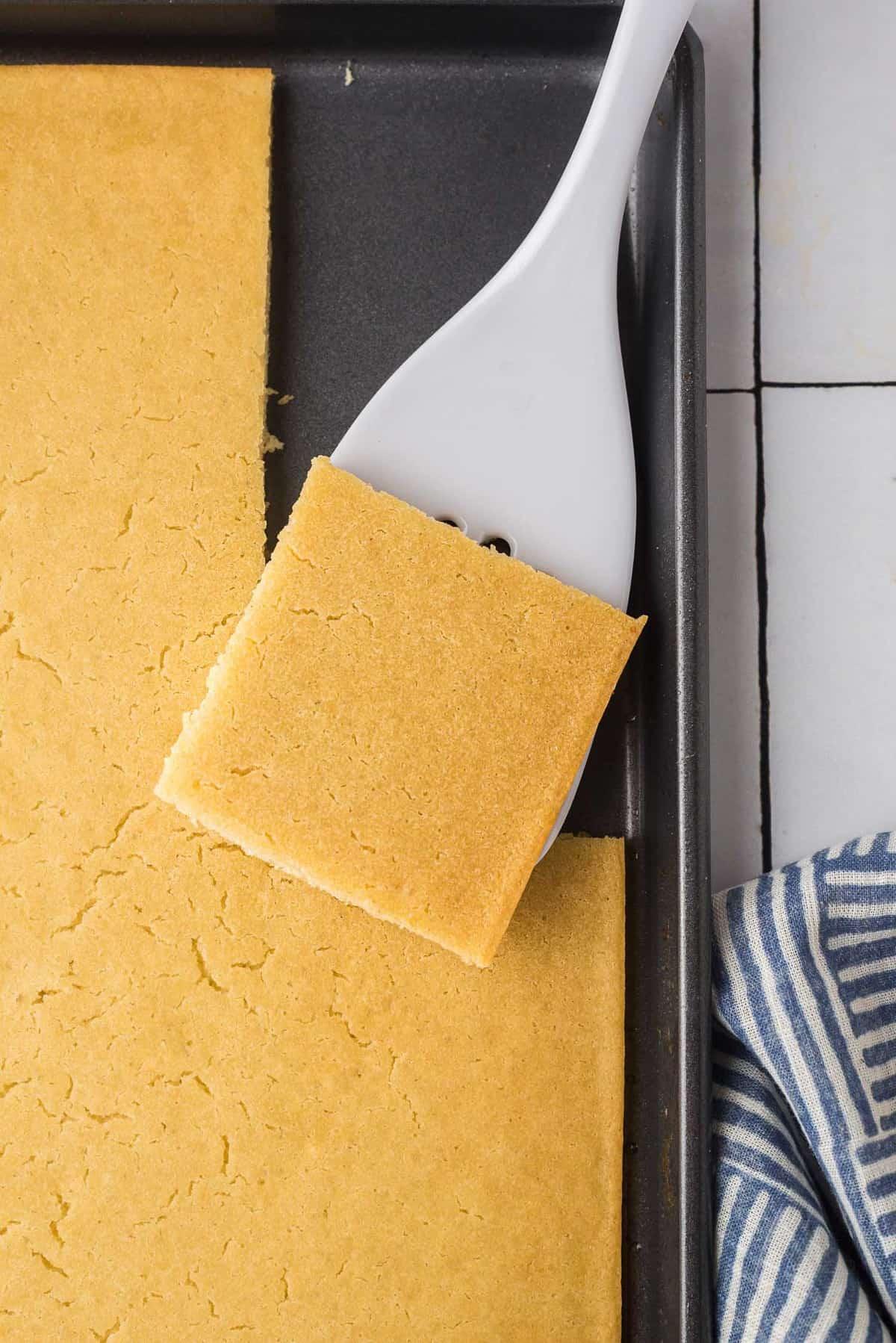 Close up of a square cut pancake on a spatula.