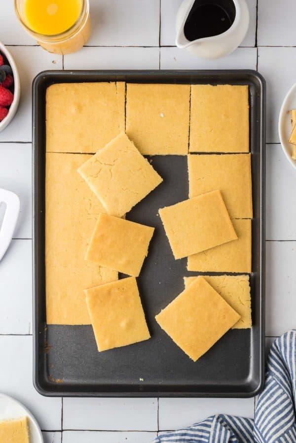 Sheet pan pancake cut into squares.
