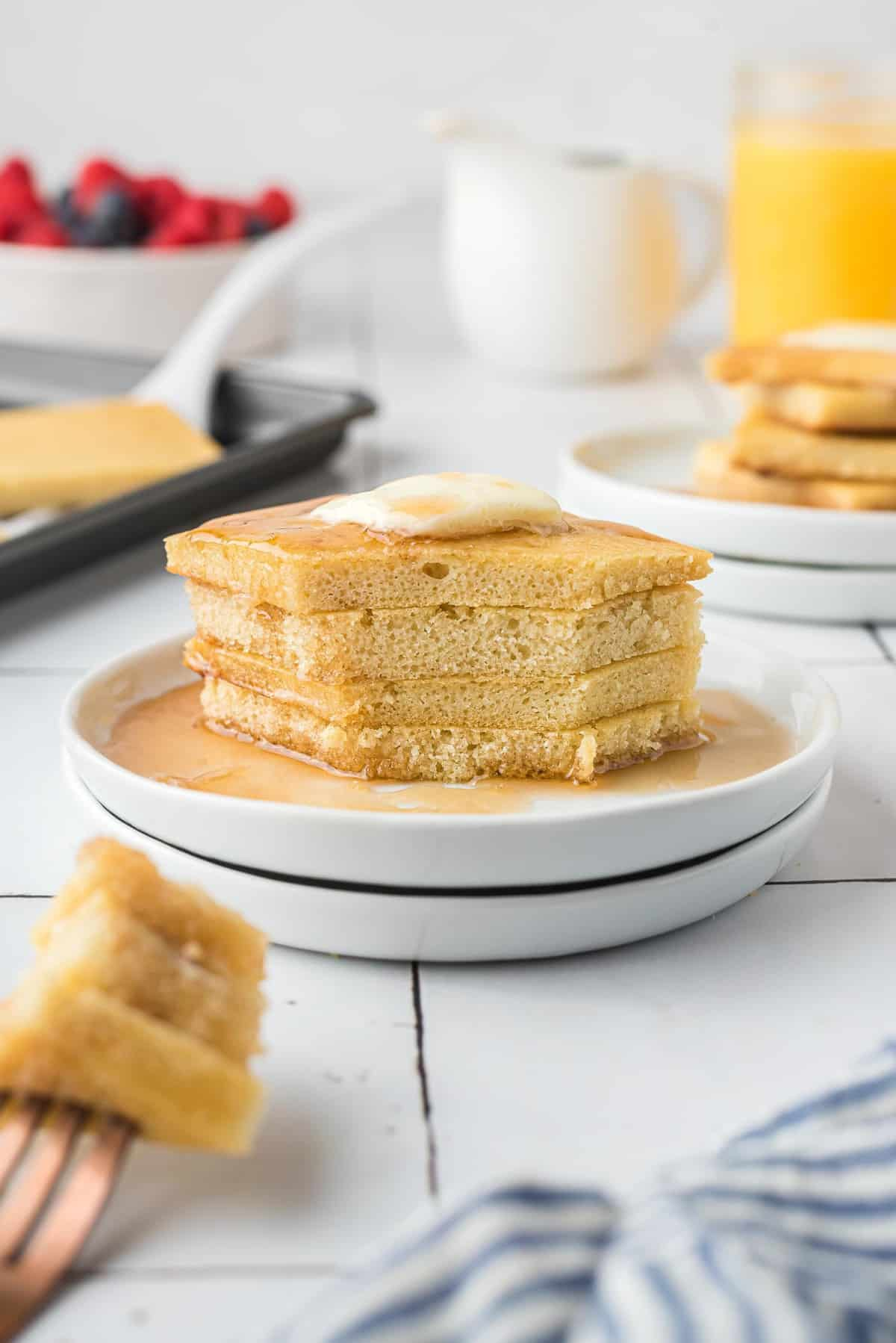 Stack of pancakes with cut out of them.