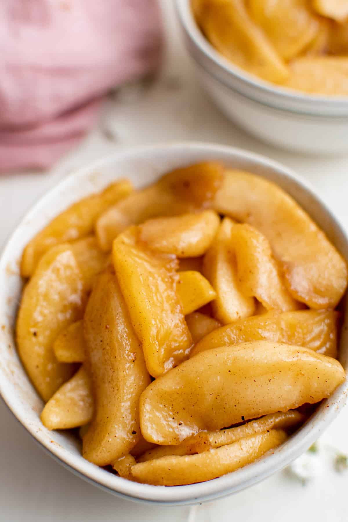 Fried apples in a small white bowl.