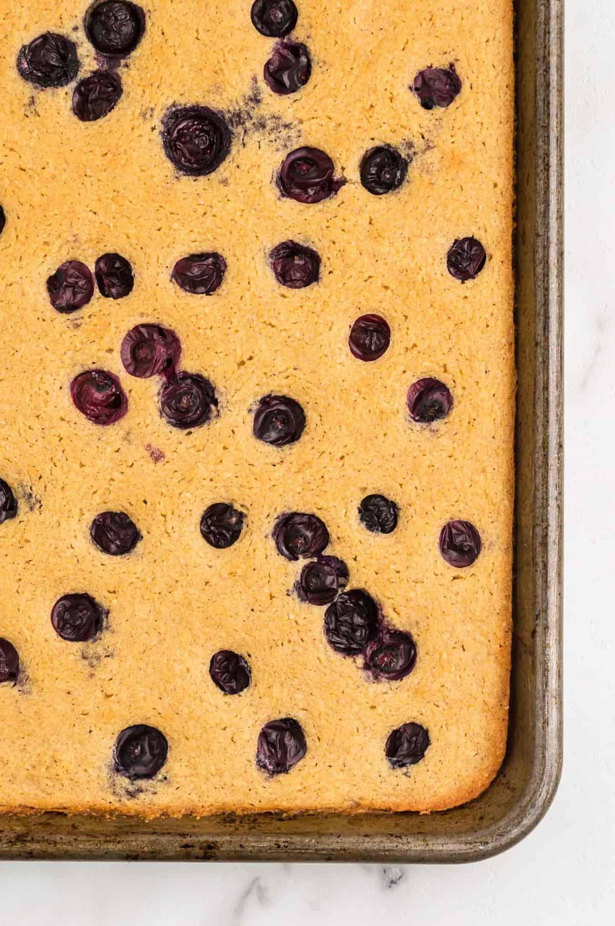 Close up of blueberry sheet pan pancake.