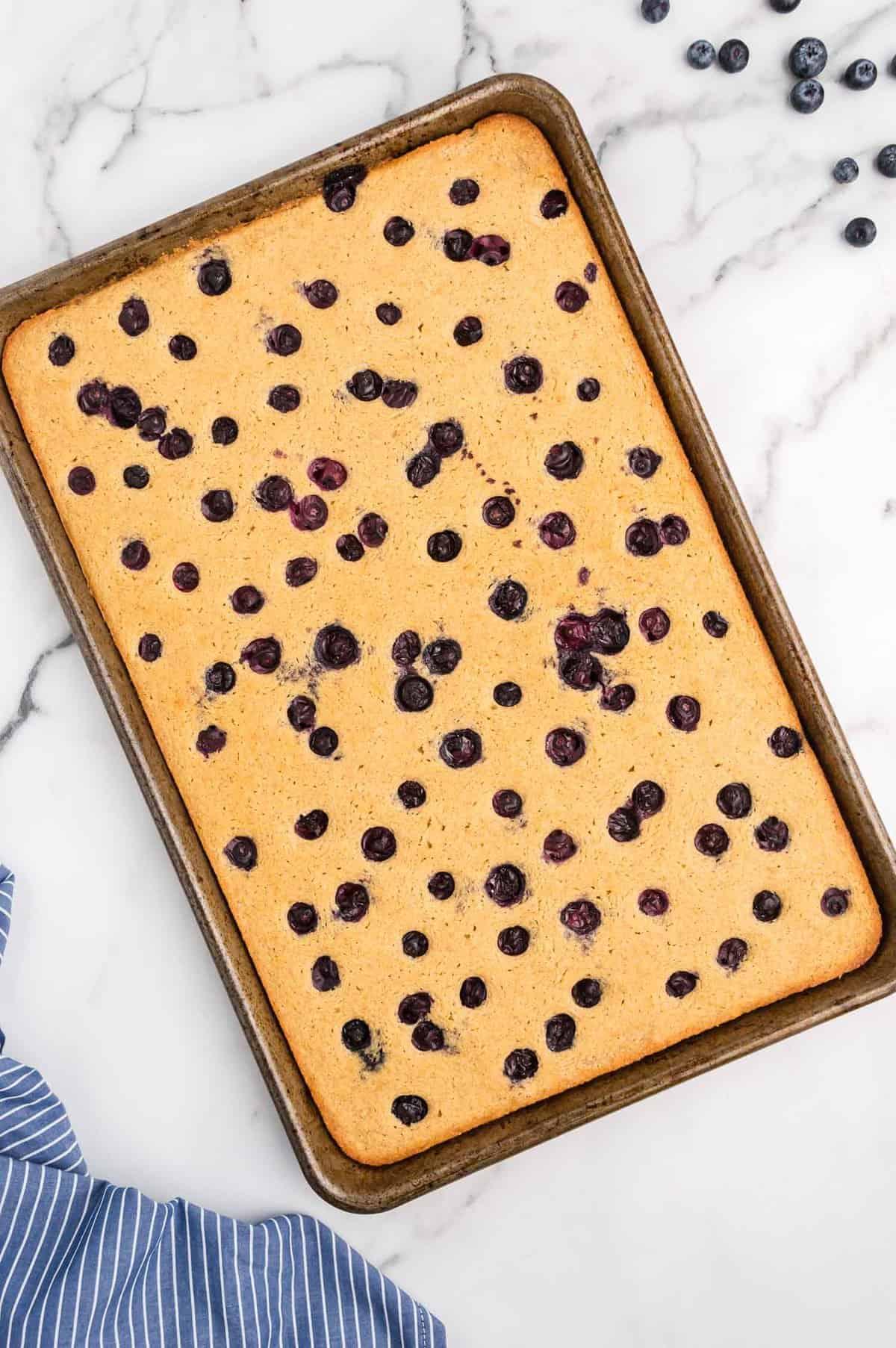 Baked sheet pan pancake with blueberries.