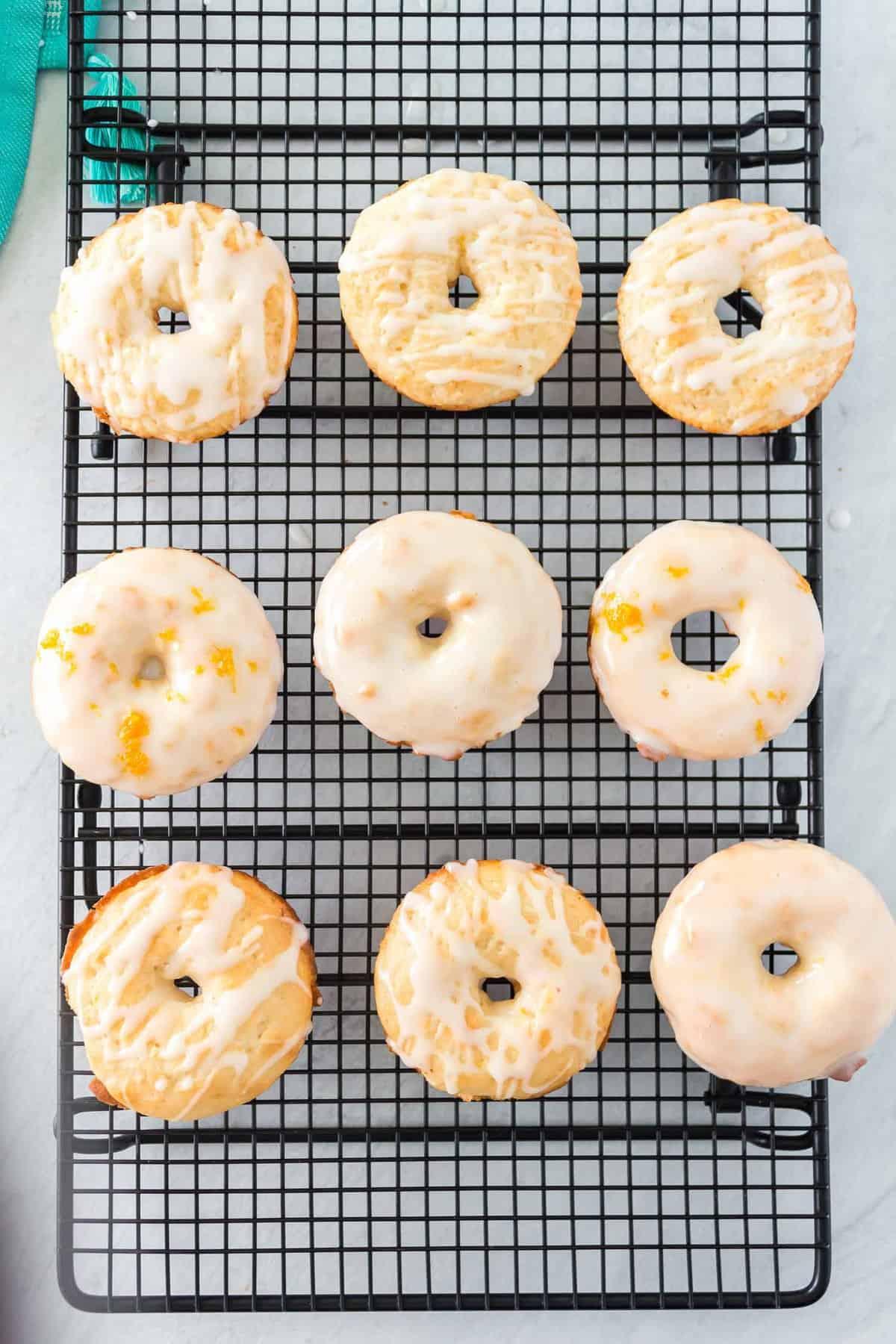 Glazed lemon donuts on a cooling rack.
