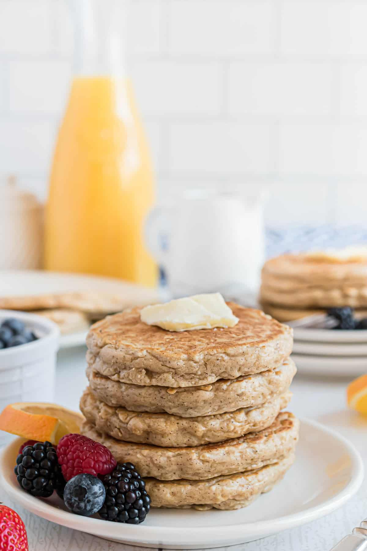 Stack of pancakes with butter.