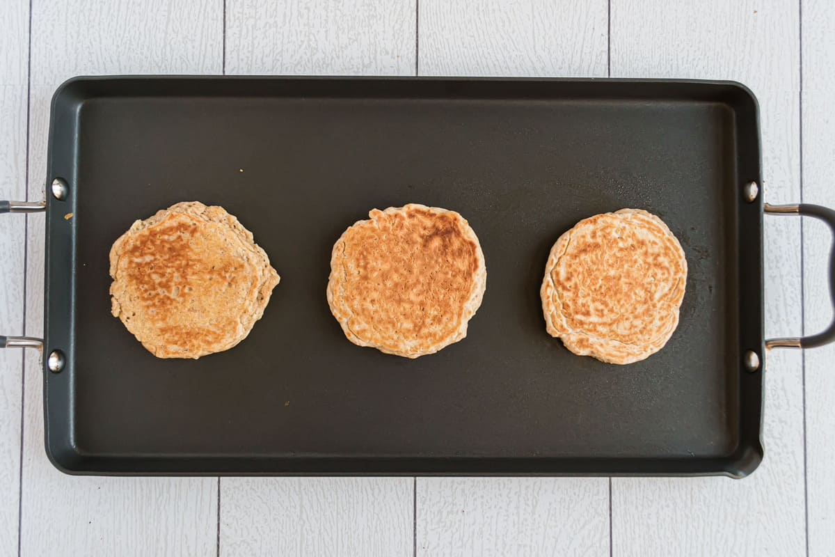 Cooked pancakes on a griddle.
