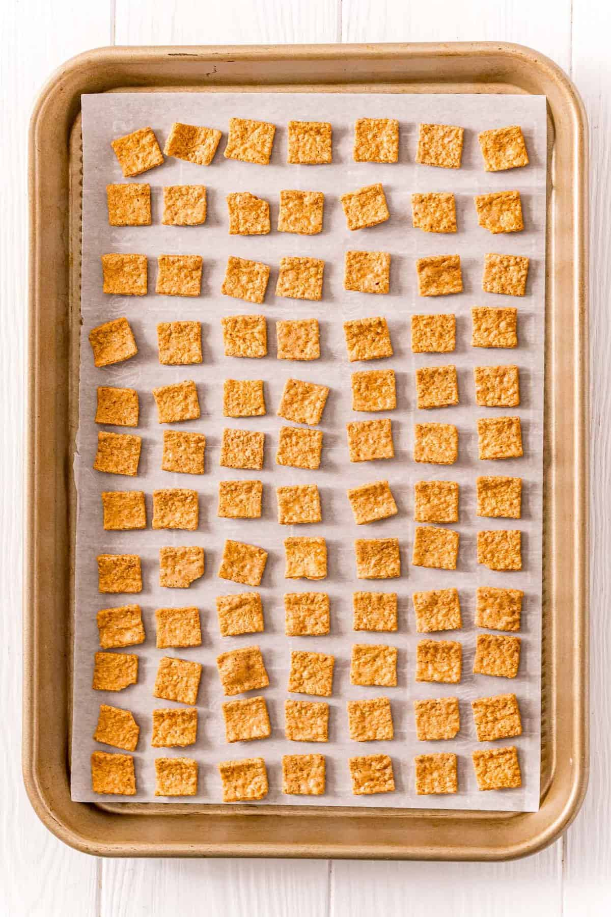 Golden Graham cereal laid out on a baking sheet.