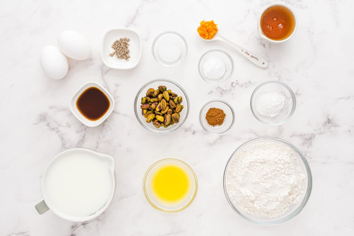 Overhead view of many ingredients in small individual bowls.