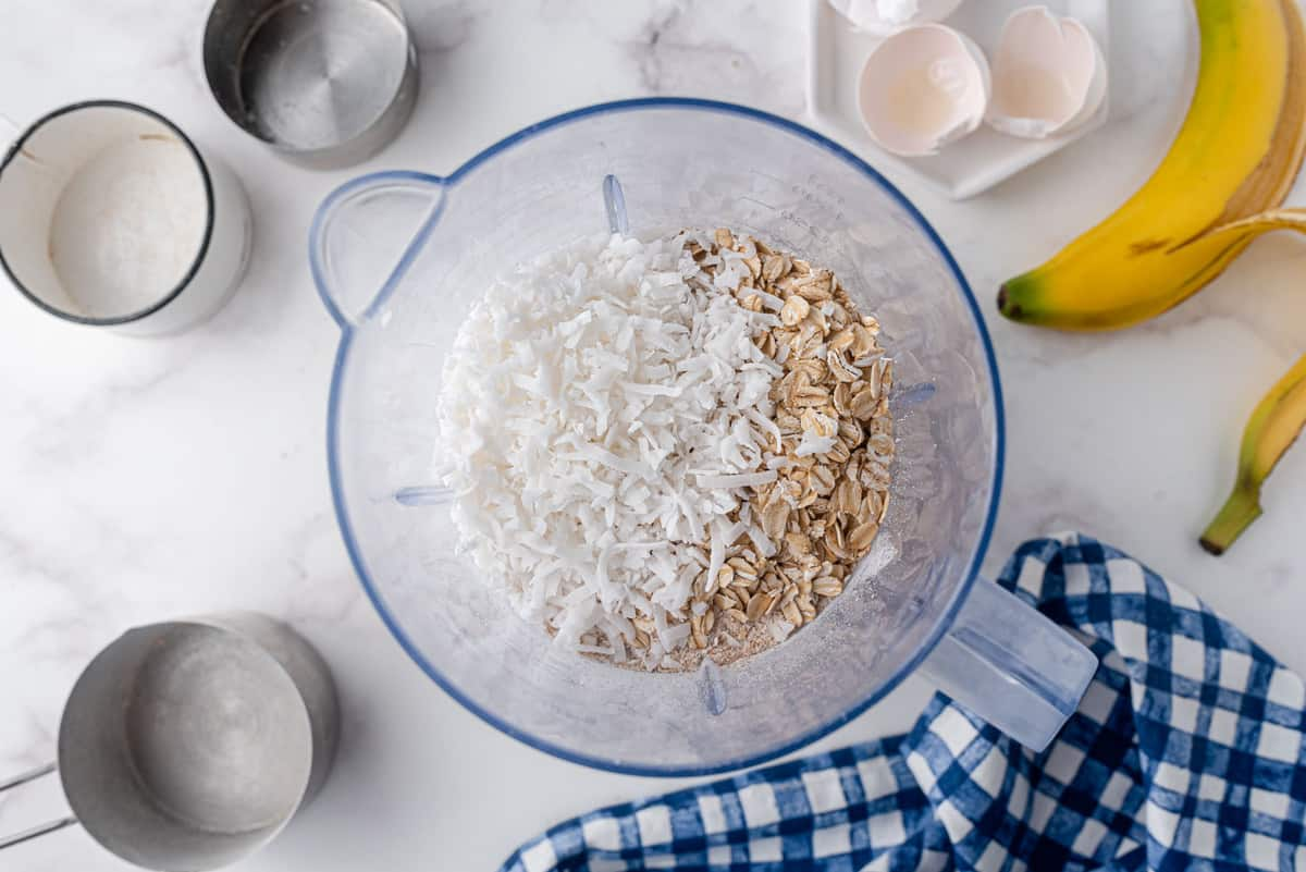 Oats and coconut in a blender.