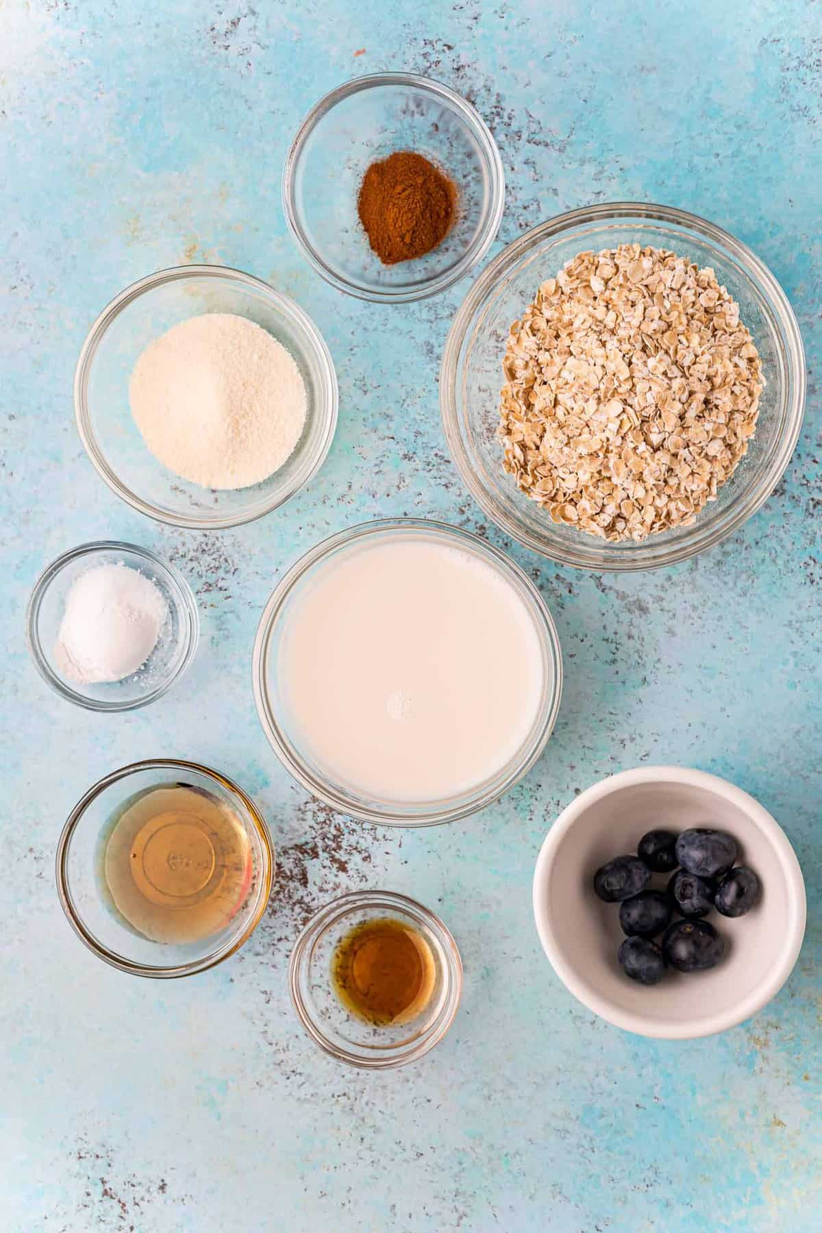Overhead view of ingredients needed, on a blue background.