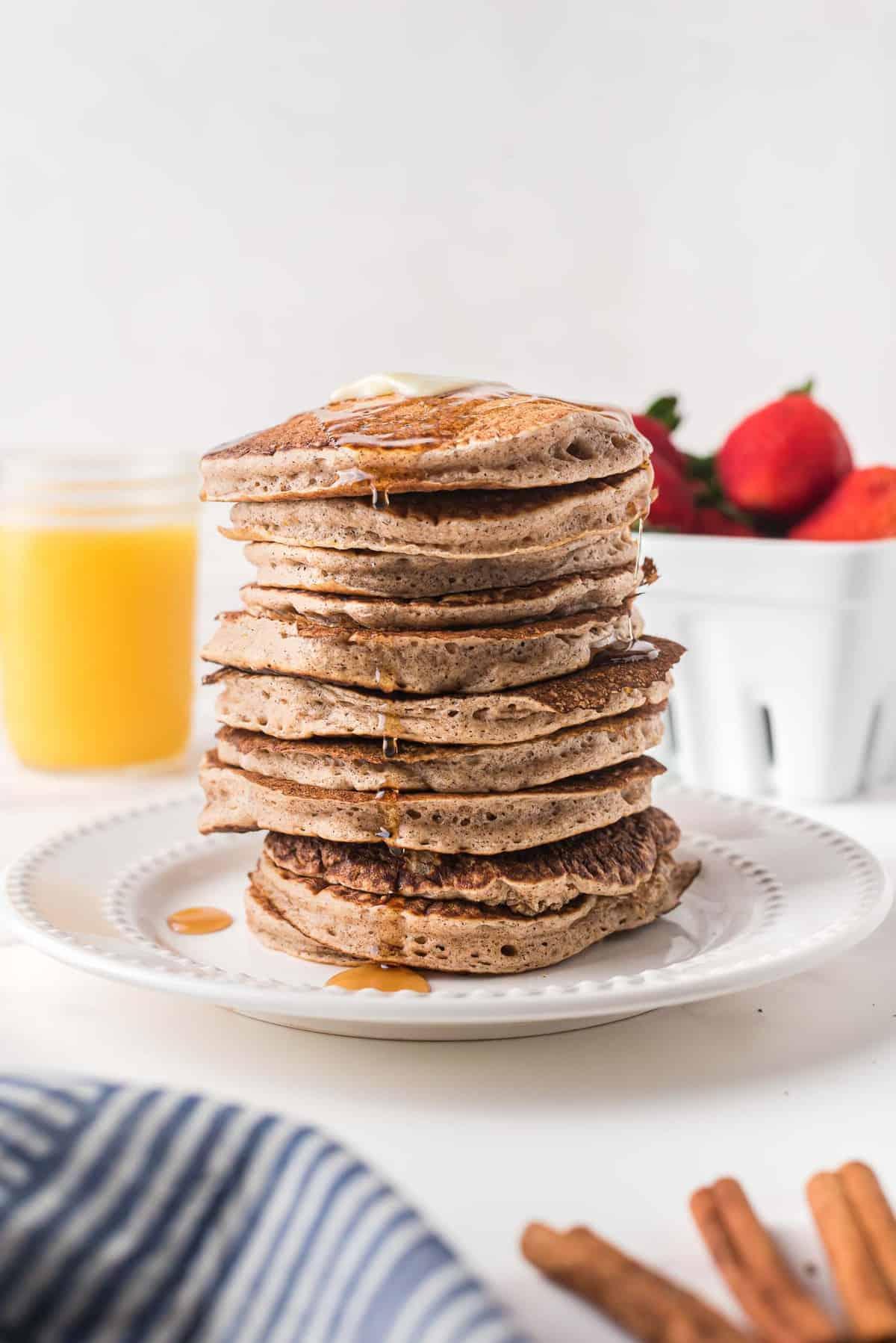 Very tall stack of cinnamon pancakes.