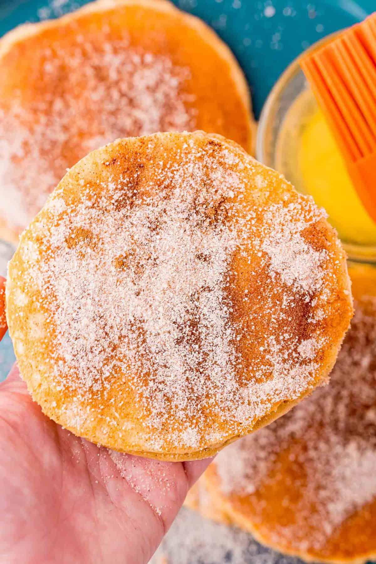 Pancake coated in cinnamon sugar.