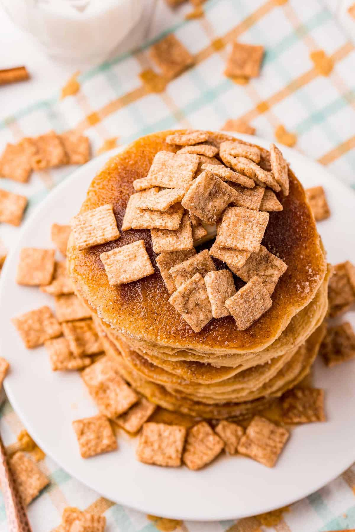 Overhead view of pancakes topped with cinnamon toast crunch.