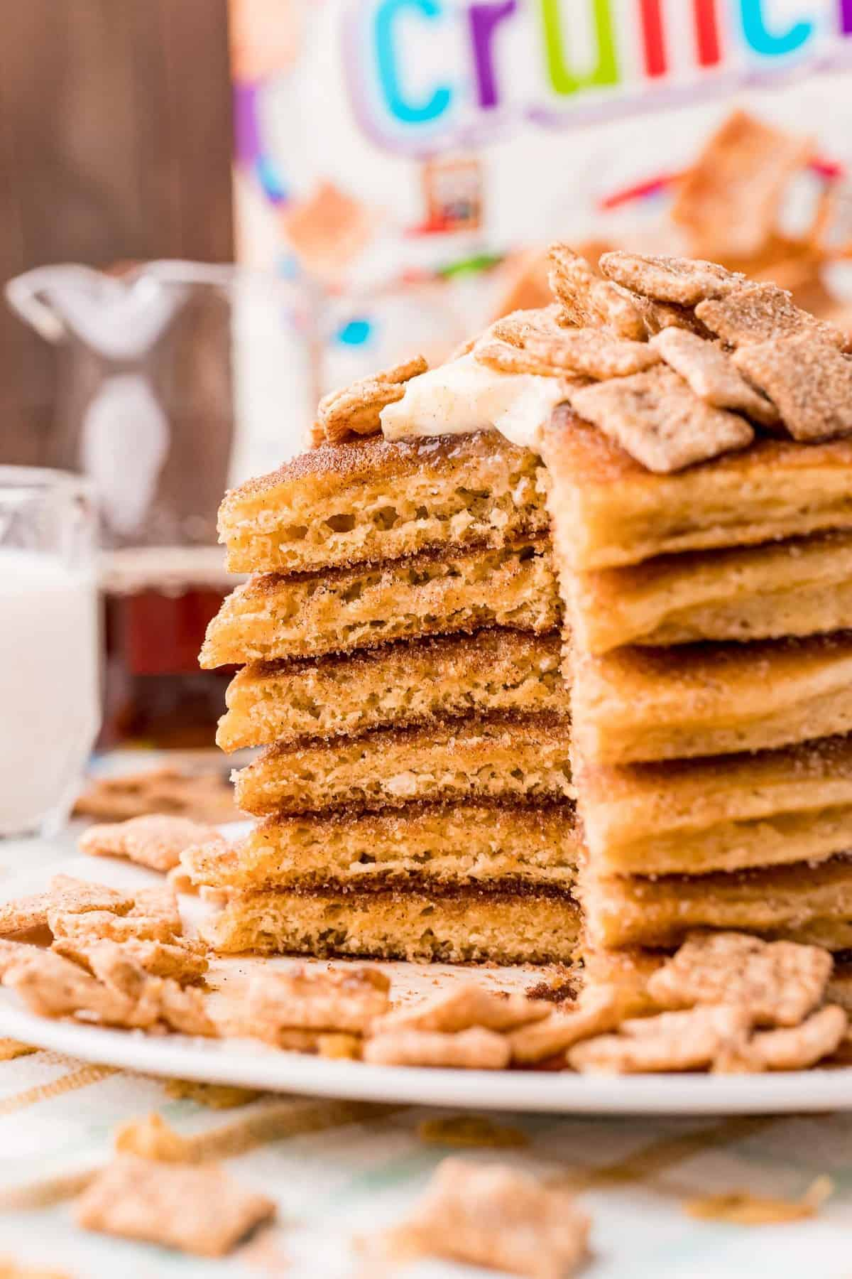 Stack of pancakes with a cut taken out to show texture.