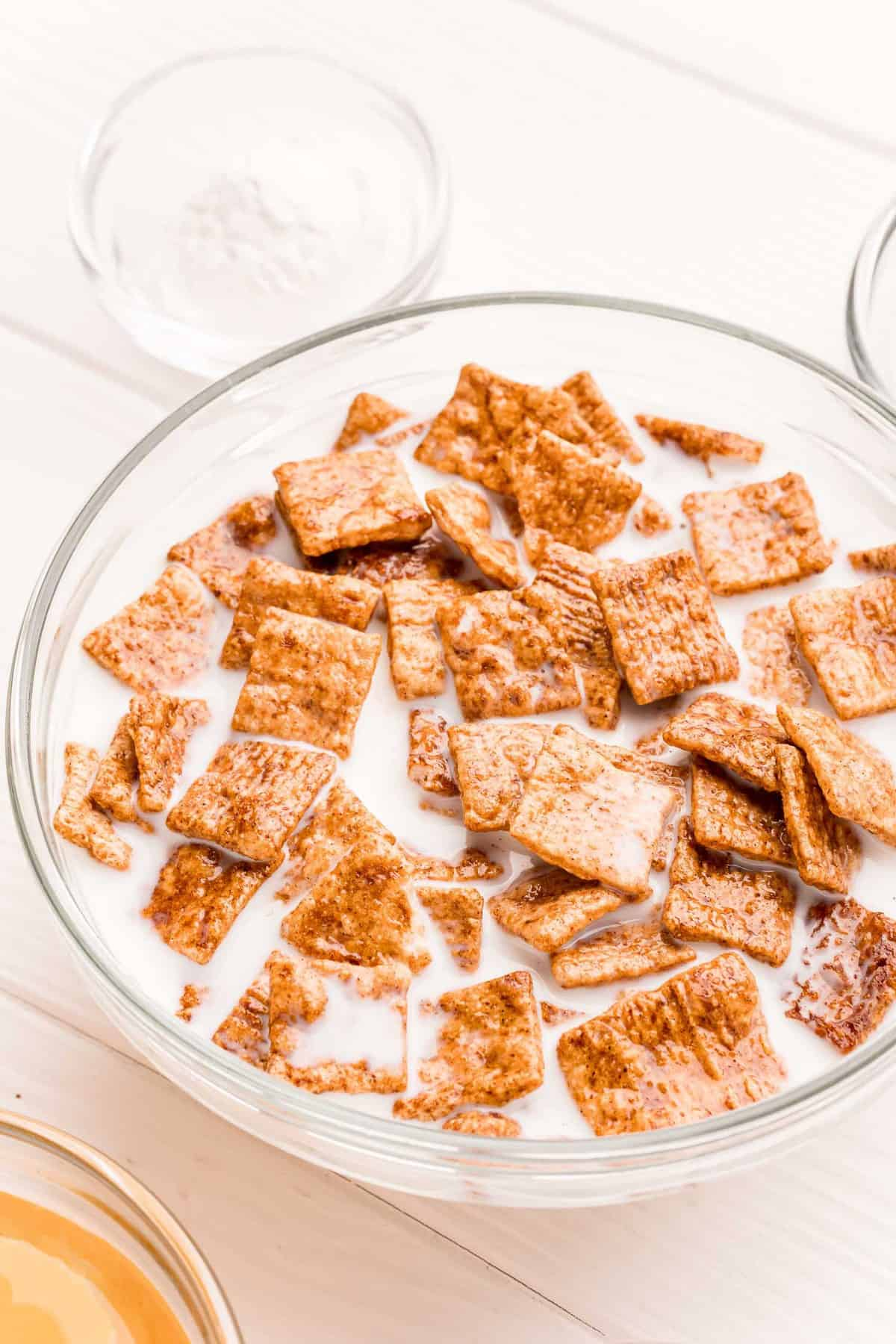 Cereal soaking in a bowl of milk.