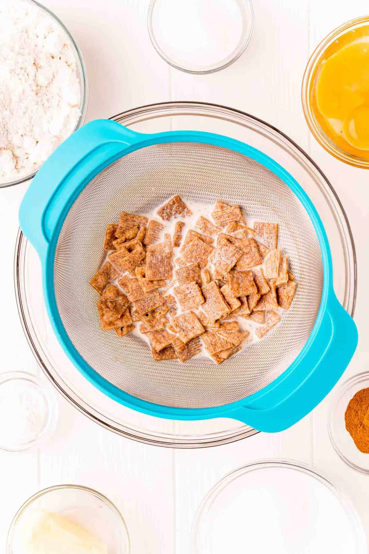 Cereal in a fine mesh strainer.