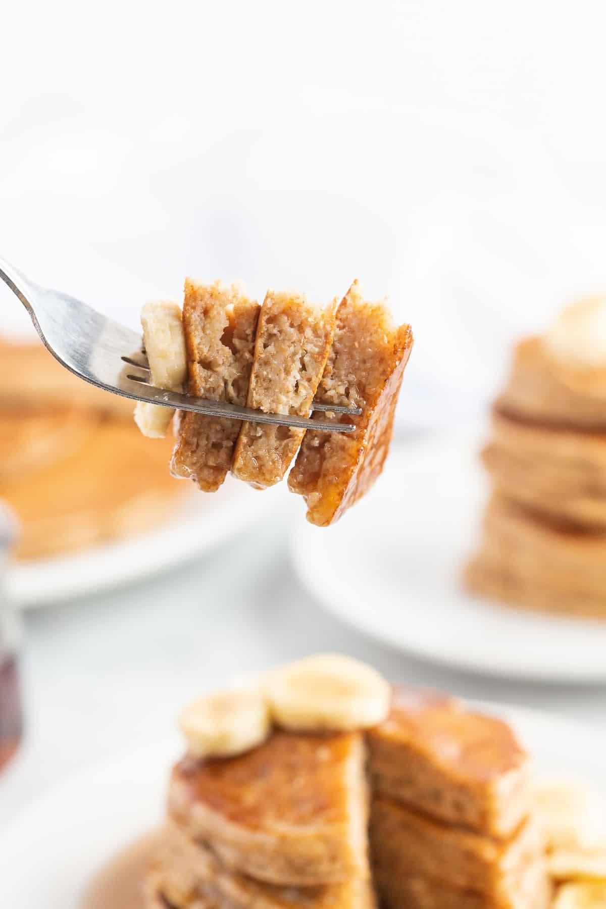 Healthy banana pancakes on a fork.