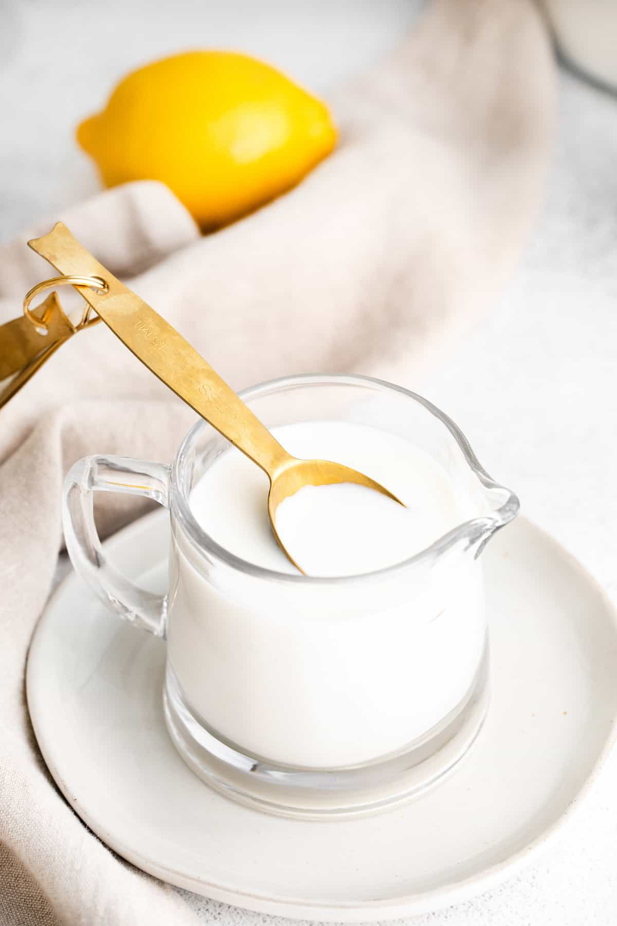 Spoon in small pitcher of buttermilk.