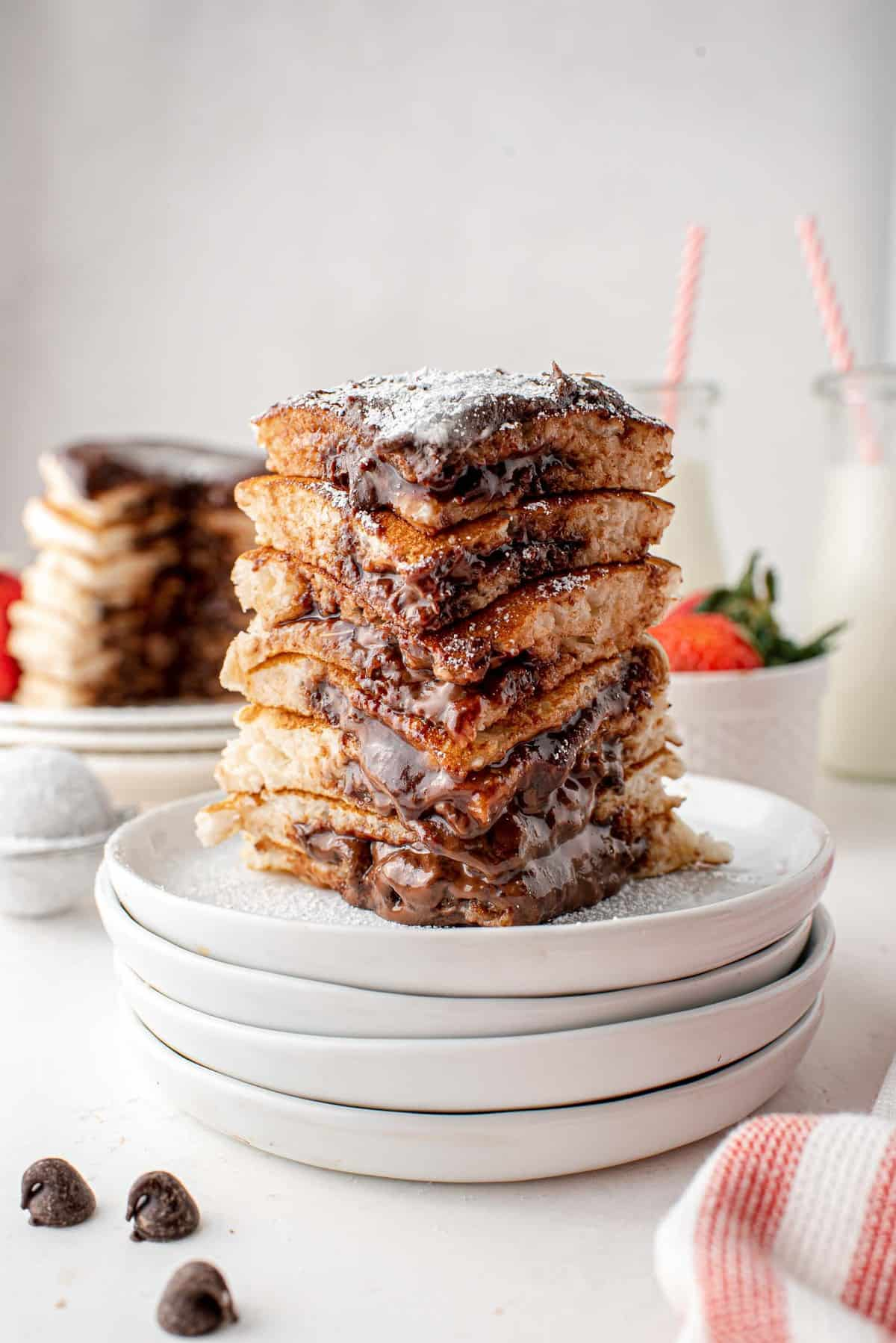 Wedge of a stack of nutella pancakes.