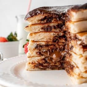 Pancakes cut open to show chocolate filling.