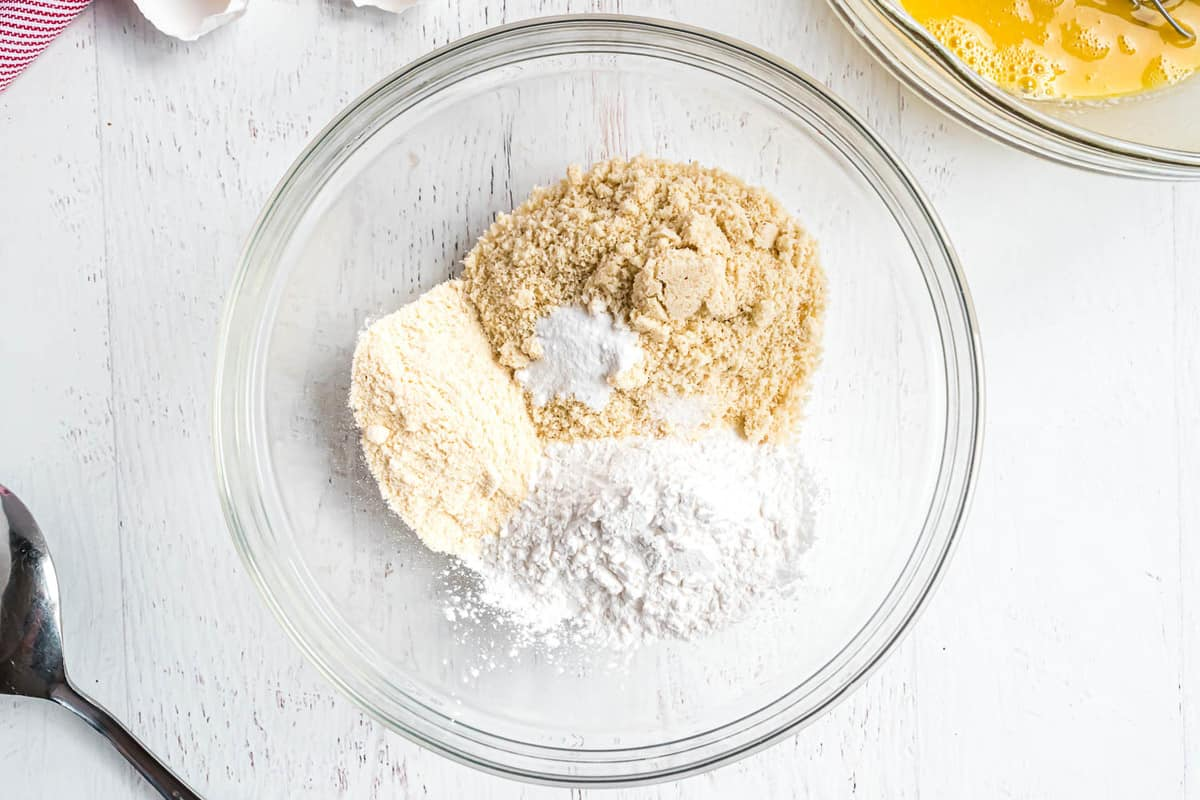 Flours in a clear glass mixing bowl.