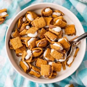 Tiny s'mores cereal in a white bowl.