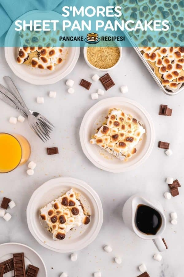 """Square of pancakes on plates, text overlay reads """"S'mores sheet pan pancakes, pancakerecipes.com"""""""