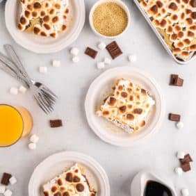 Overhead view of marshmallow topped square pancakes. Marshmallows and chocolate scattered around.
