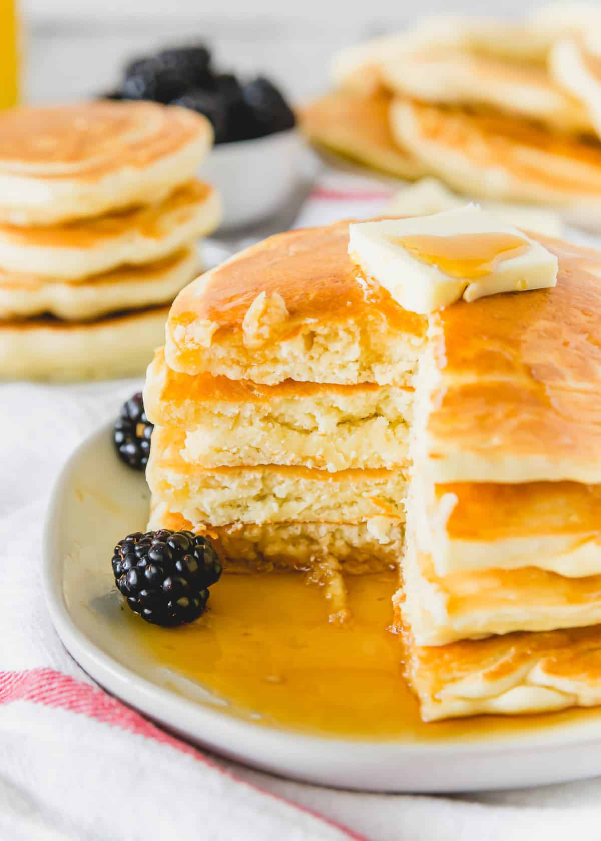 Stack of pancakes, cut to show texture.