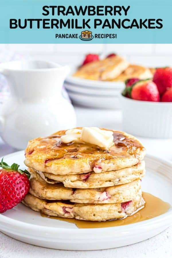 """A stack of pancakes with a text overlay that reads """"strawberry buttermilk pancakes, pancakerecipes.com"""""""