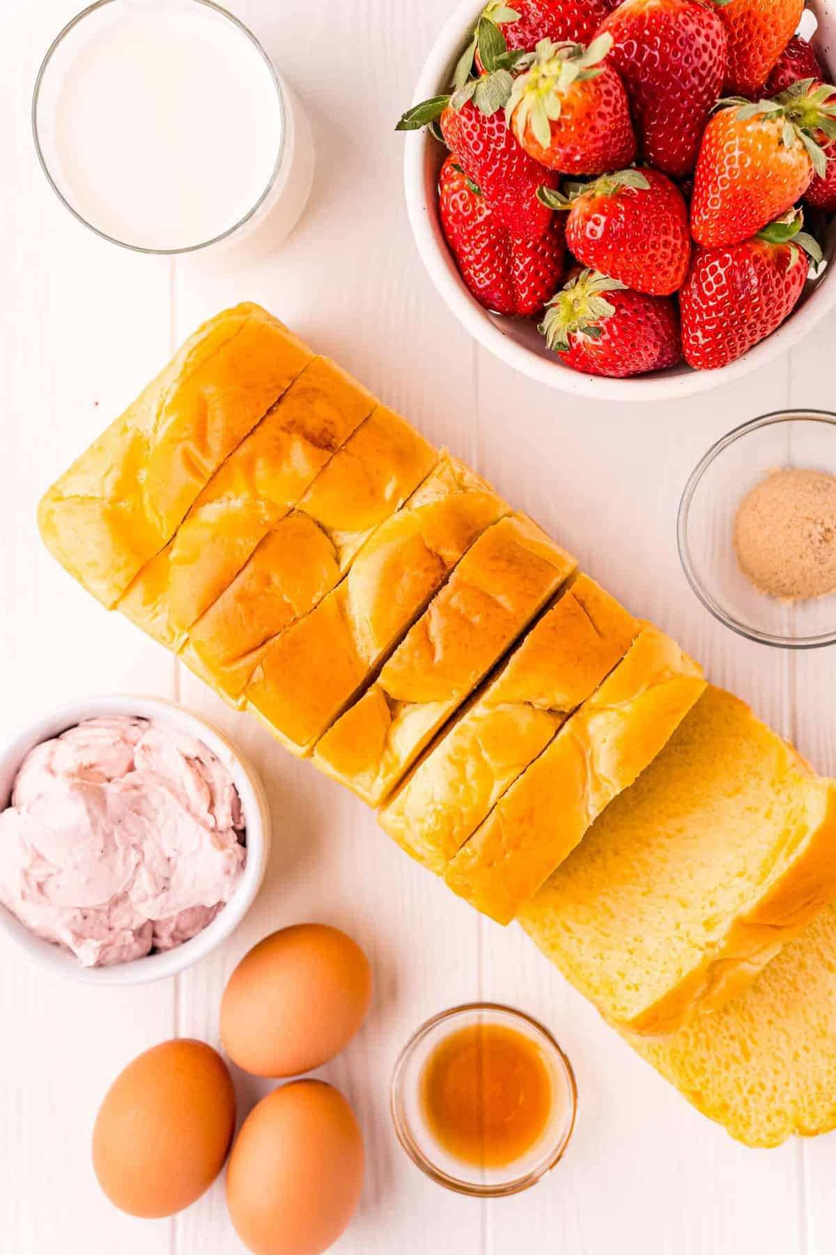 Overhead view of ingredients needed for strawberry cheesecake french toast.
