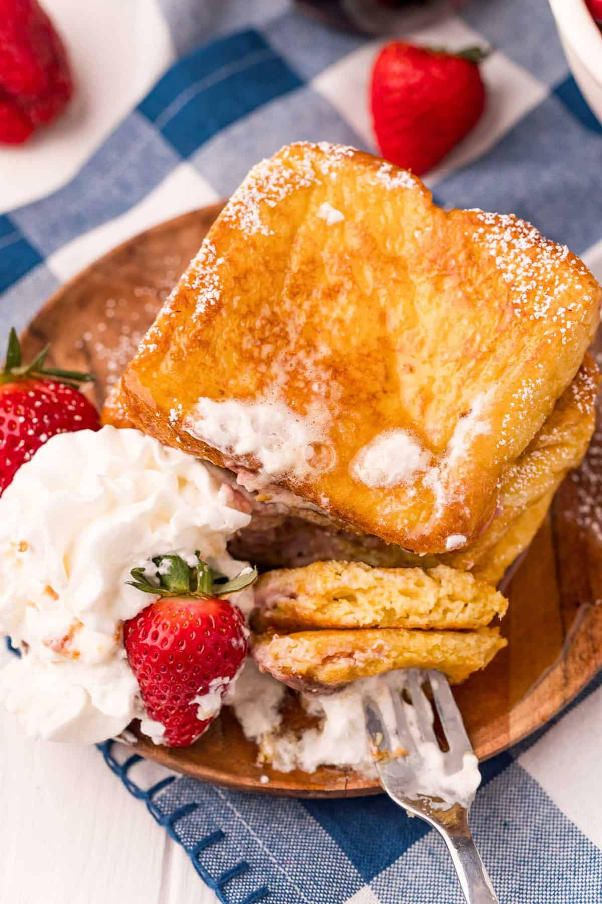 Stuffed french toast, with some on a fork.