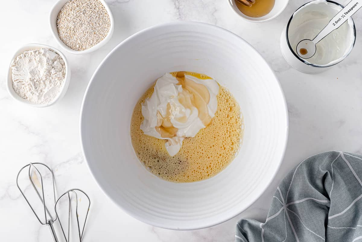 Yogurt and vanilla on top of beaten eggs.