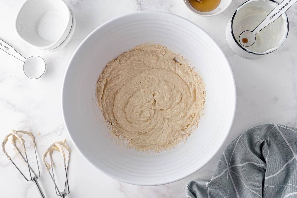 Pancake batter in white mixing bowl.