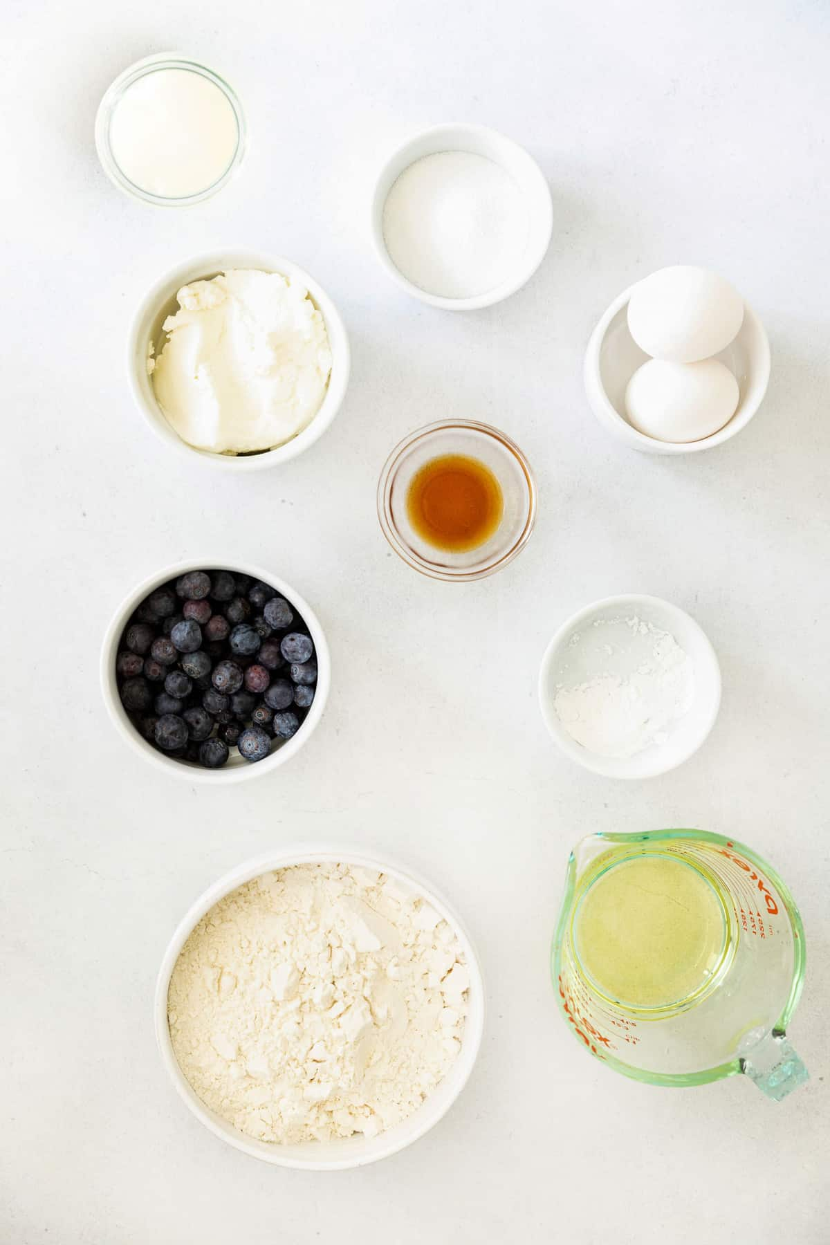 Overhead view of ingredients needed for recipe, including ricotta cheese and blueberries.