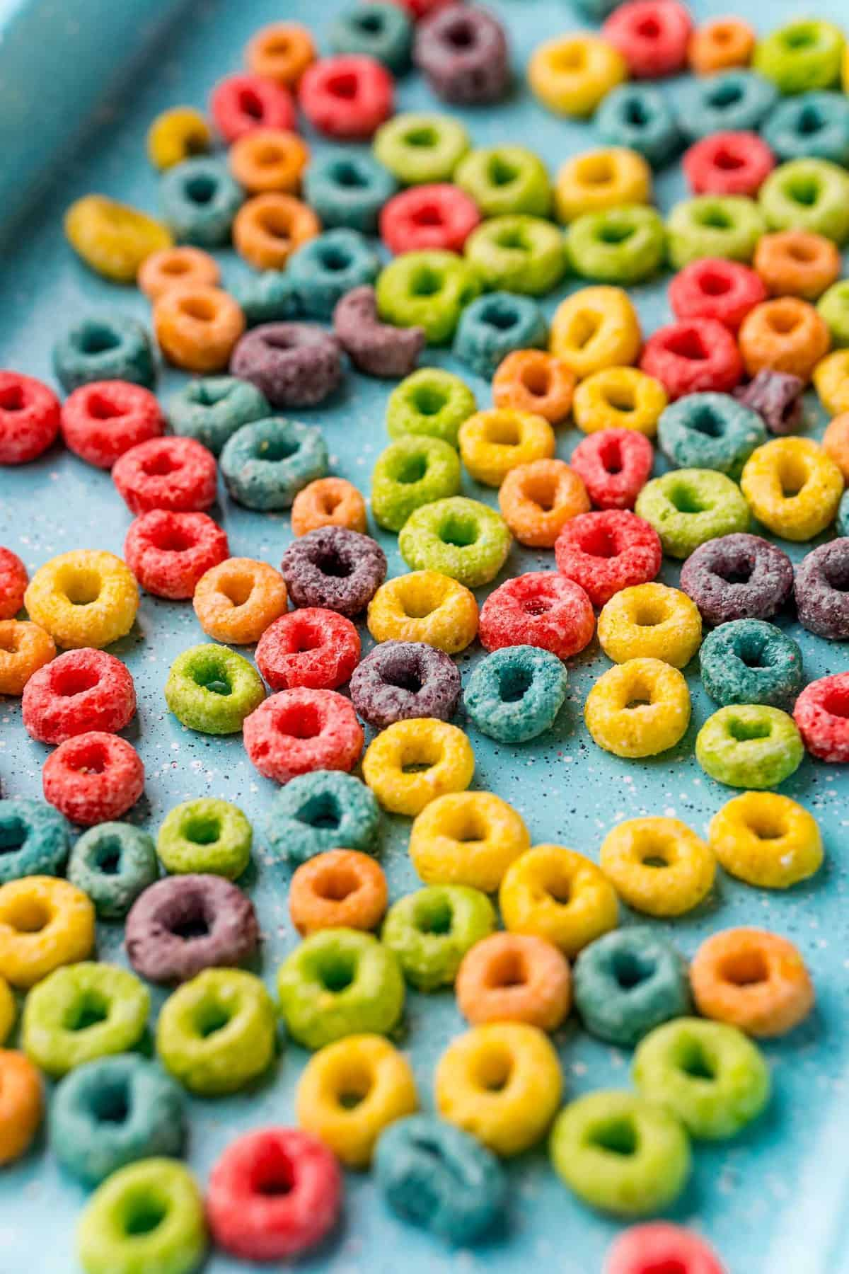 Froot loops on a blue baking sheet.