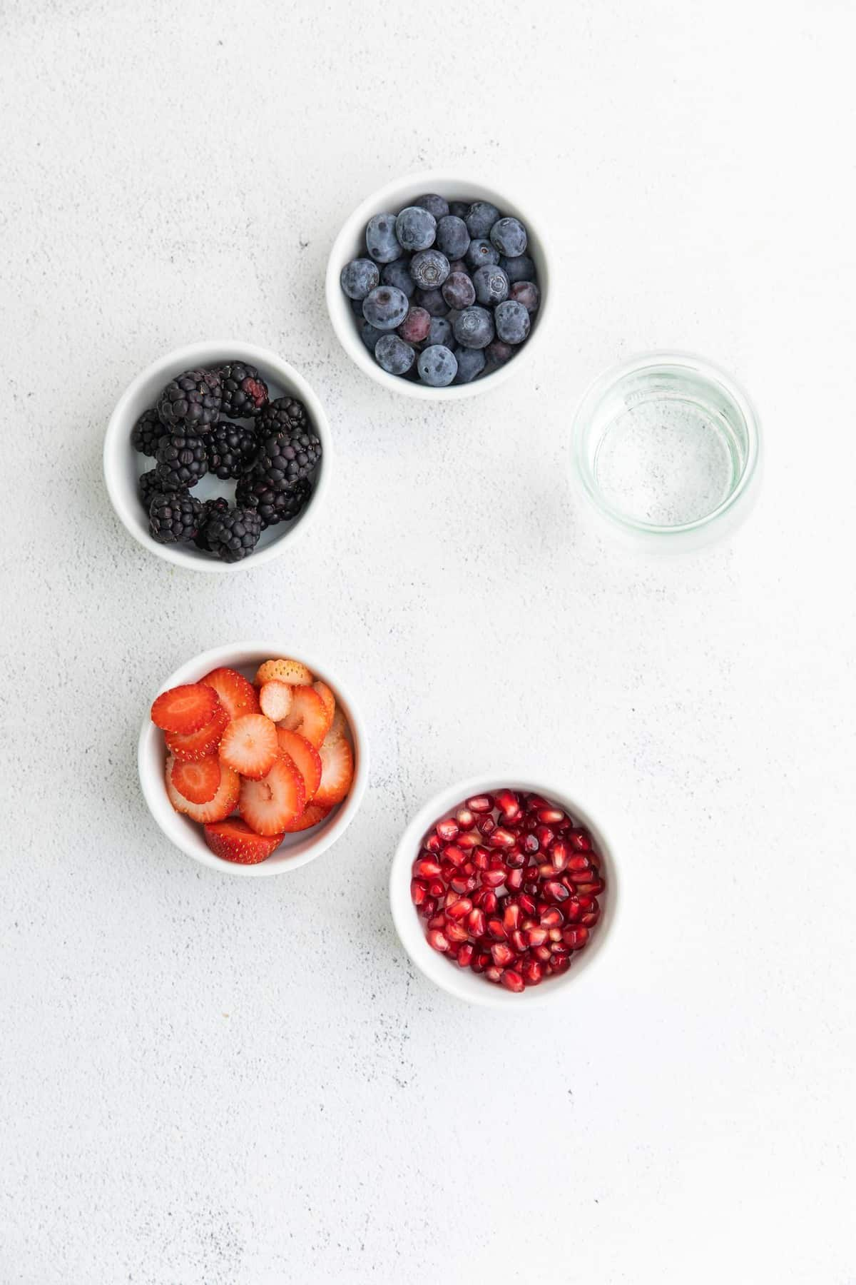 Fruit in separate bowls.