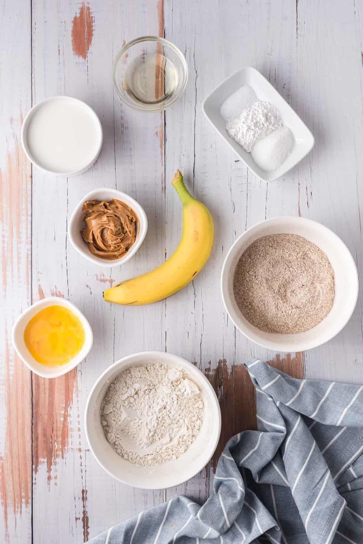 Overhead view of ingredients in small bowls, and a banana.