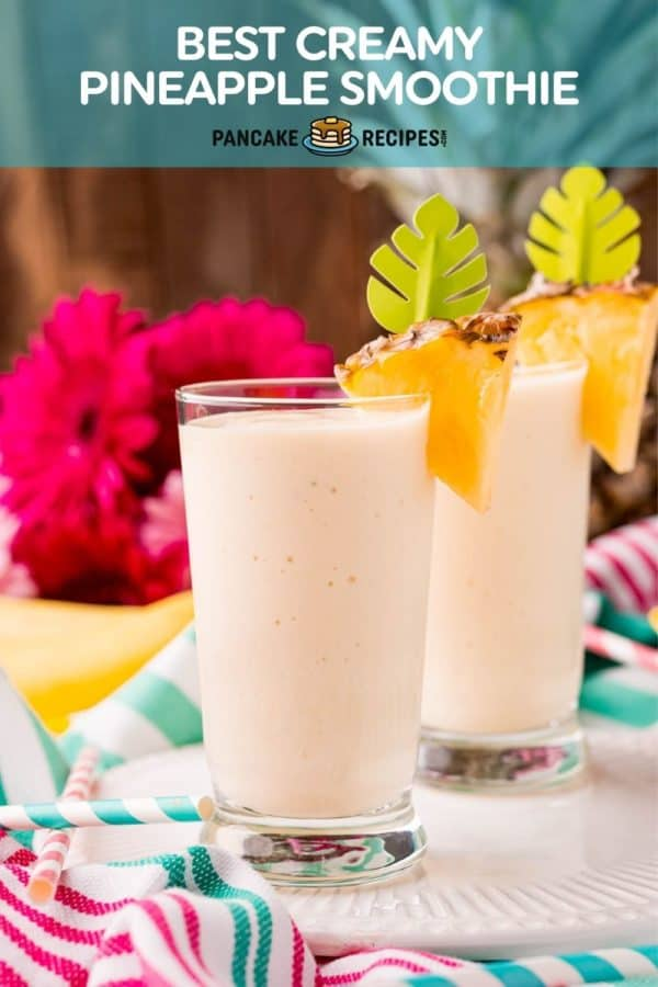 """Two light yellow smoothies, text overlay reads """"best creamy pineapple smoothie, pancakerecipes.com"""""""