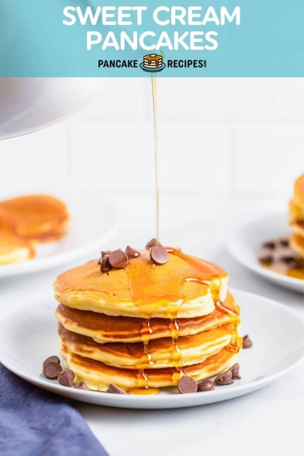 """Syrup being poured on pancakes, text overlay reads """"sweet cream pancakes, pancakerecipes.com"""""""