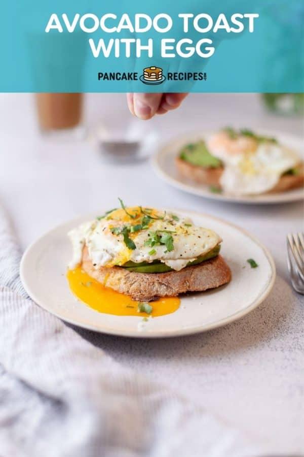 "Avocado toast on a plate, text overlay reads ""avocado toast with egg, pancakerecipes.com."""