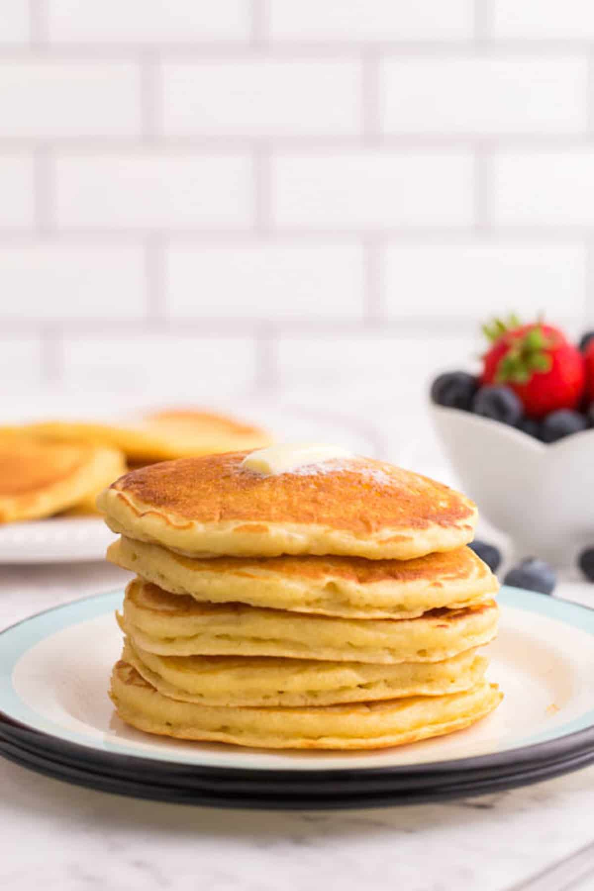Stack of fluffy pancakes on a plate.