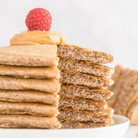 Stack of keto pancakes with a slice taken out to show texture.